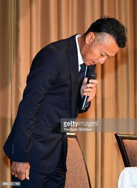 Professional golfer Shingo Katayama bows for apology during a press conference on June 27, 2018 in Tokyo, Japan. A male guest was part of golfer...