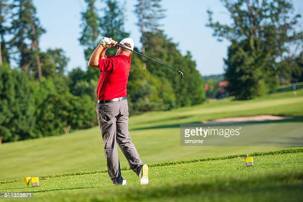 professional golfer teeing off - golf swing stock pictures, royalty-free photos & images
