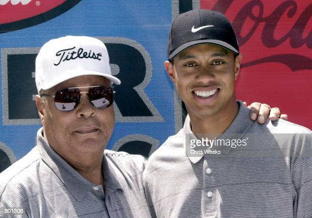 Professional golfer Tiger Woods and his father Earl Woods arrive at a press conference April 14 2001 at the CocaCola Tiger Woods Foundation Junior...