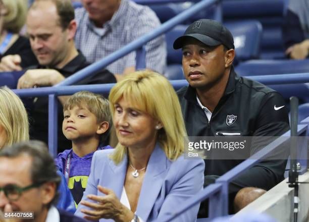 Professional golfer Tiger Woods and his son Charlie Axel Woods attend Day Twelve of the 2017 US Open at the USTA Billie Jean King National Tennis...