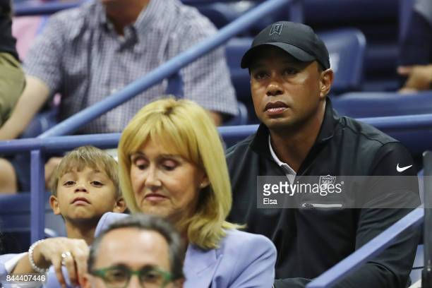 Professional golfer Tiger Woods and his son Charlie Axel Woods attends Day Twelve of the 2017 US Open at the USTA Billie Jean King National Tennis...