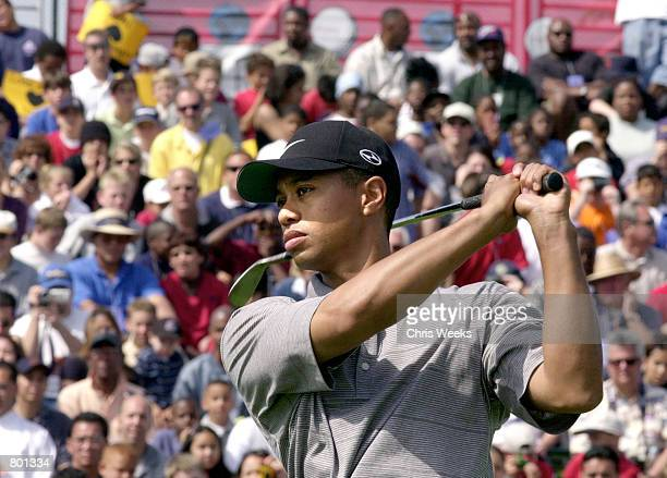 Professional golfer Tiger Woods demonstrates a golf swing for the crowd April 14 2001 at the CocaCola Tiger Woods Foundation Junior Golf Clinic at...