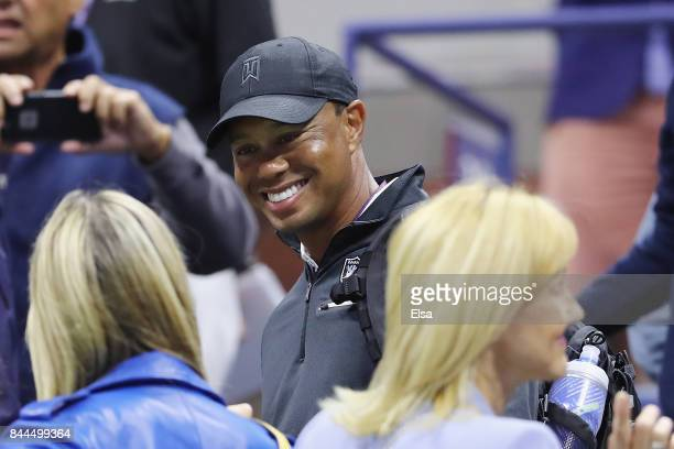 Professional golfer Tiger Woods smiles after Rafael Nadal of Spain defeated Juan Martin del Potro of Argentina in their Men's Singles Semifinal match...