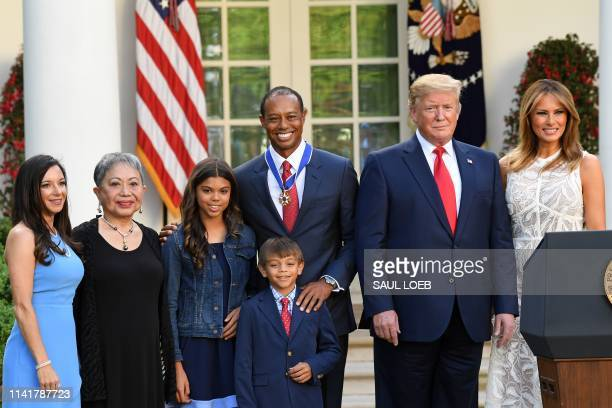 Professional golfer Tiger Woods stands with his girlfriend Erica Herman Kultida Woods Sam Alexis Woods Charlie Axel Woods US President Donald Trump...
