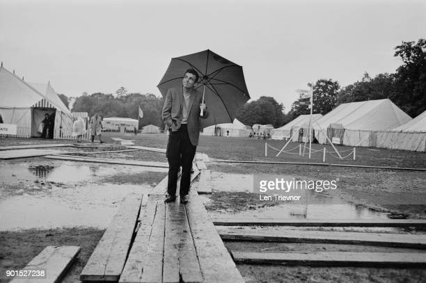 Professional golfer Tony Jacklin inspecting waterlogged course during the Piccadilly World Match Play Championship Virginia Water UK October 1968