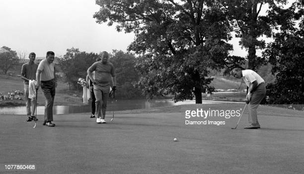 Professional golfers Jug McSpaden, Jack Nicklaus, and Arnold Palmer participate in an exhibition event on August 12, 1968 at the McSpaden designed...