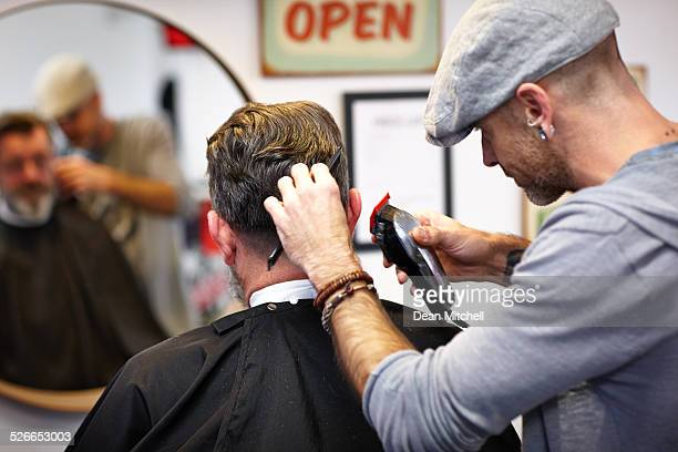 professional hairdresser trimming client's hair - male maldives stock pictures, royalty-free photos & images