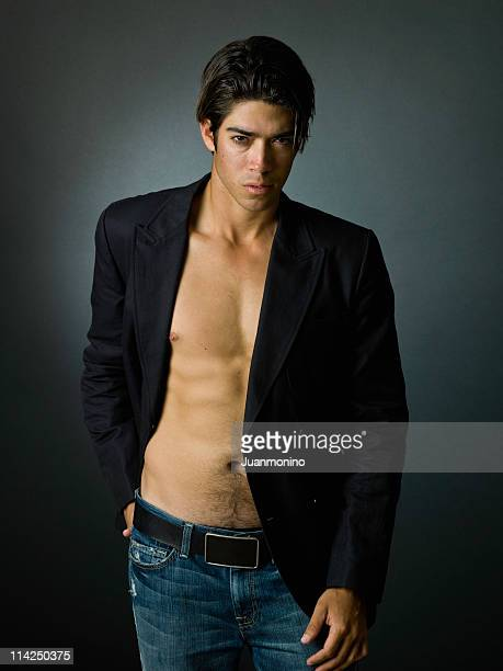 professional hispanic male model - male belly button stock photos and pictures