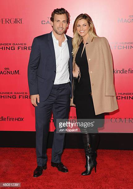 Professional hockey player Jarret Stoll and sportscaster Erin Andrews arrive at the Los Angeles Premiere The Hunger Games Catching Fire at Nokia...