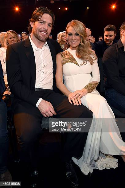 Professional hockey player Mike Fischer and recording artist Carrie Underwood attend the 2014 American Country Countdown Awards at Music City Center...