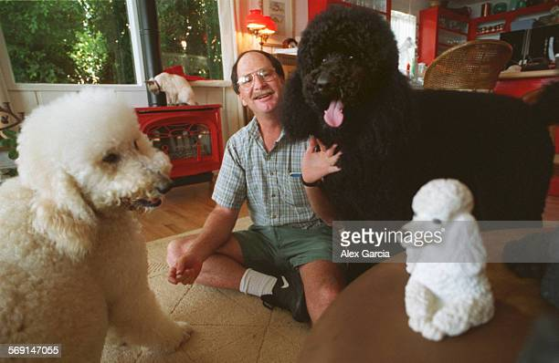 DOGSAAG––Professional house sitter Ron Armenta hangs out with dogs at a house in South Laguna that he takes care of Walking and playing wth dogs is...