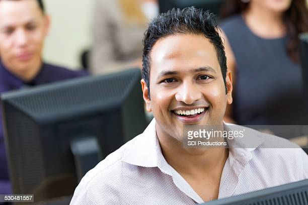 Professional Indian man working in IT computer department of company