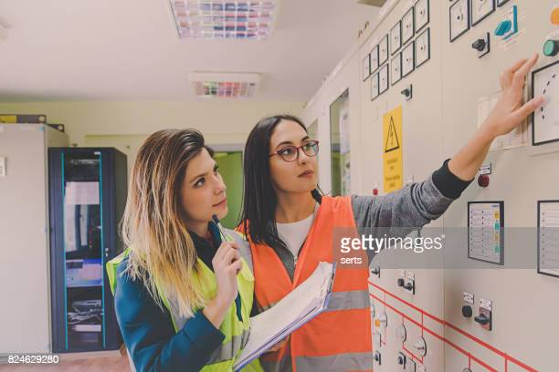 Professional industrial engineer women operating in electricity substation