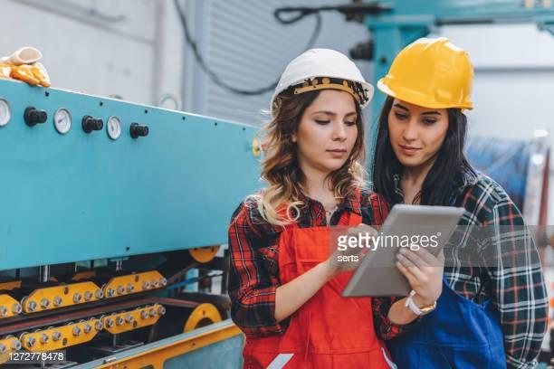 professional industrial engineer women operating in factory warehouse - fornecimento de energia imagens e fotografias de stock