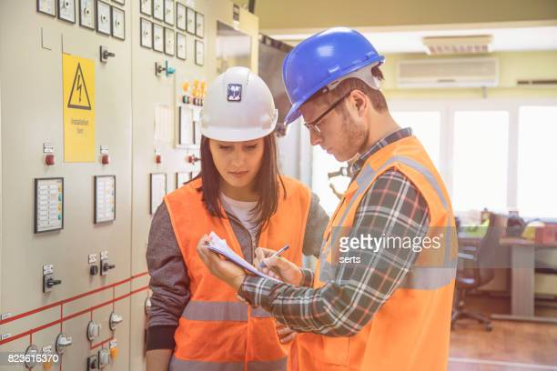 Professional industrial engineers operating in electricity substation