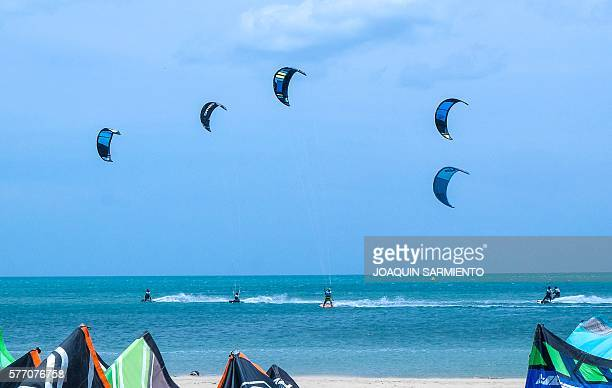 Professional kitesurfers are pictured in Cabo de la Vela Guajira Department Colombia on July 4 2016 In Cabo de la Vela a remote destination in the...
