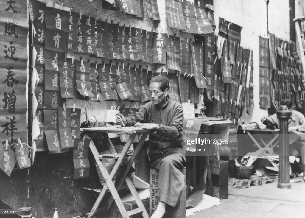 a professional letter writer at work in a street in hong kong