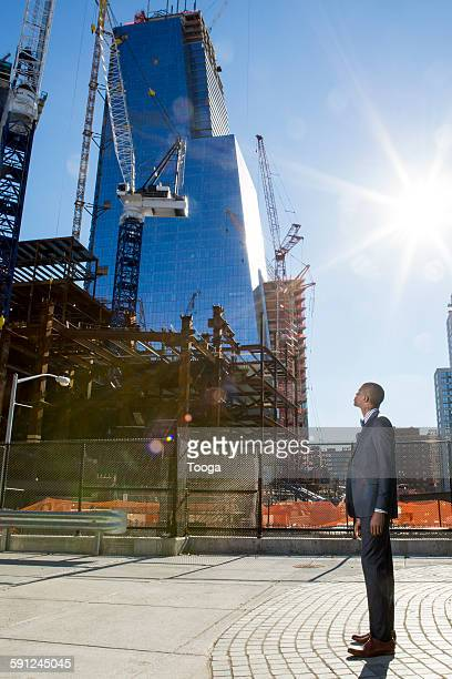 Professional looking at large construction site