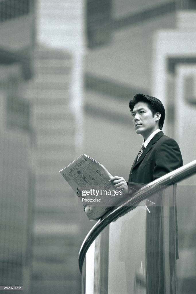 Professional looking up from paper : Stock Photo