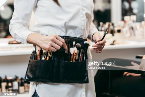 professional makeup artist at work - backstage stock pictures, royalty-free photos & images