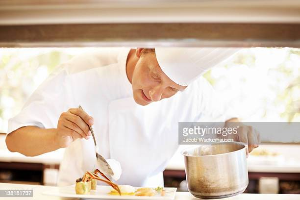 Professional male chef working in kitchen