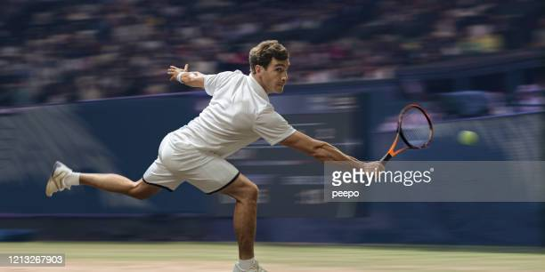 professional male tennis player in mid motion on grass court - tennis stock pictures, royalty-free photos & images