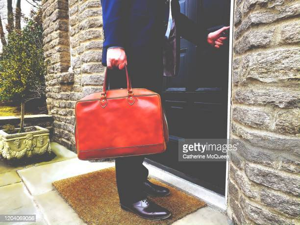 professional man arrives home from work - custom tailored suit stock pictures, royalty-free photos & images