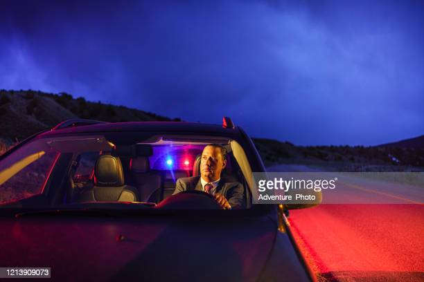 professional man in suit being pulled over by police - traffic examining stock pictures, royalty-free photos & images