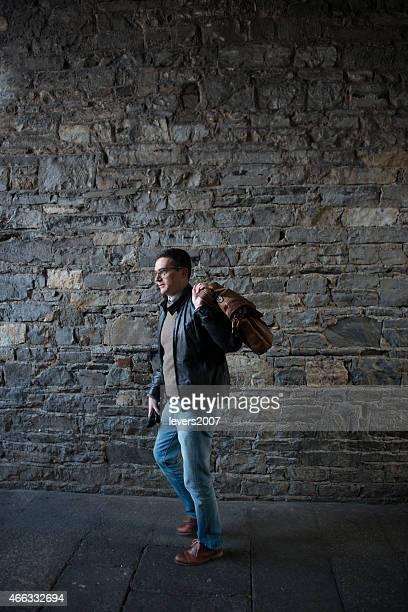 Professional man walking in city