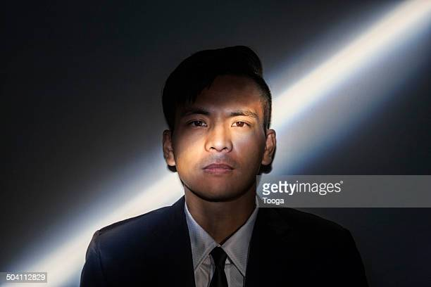 Professional man with diagonal light across face