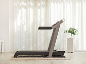 Professional modern treadmill at home