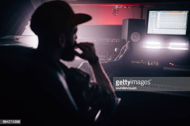 professional music producer having a break in recording studio - post-production stock pictures, royalty-free photos & images