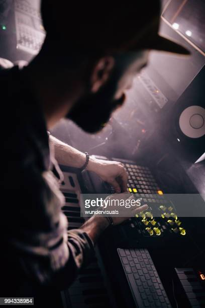 professional music producer working on sound mixer in recording studio - post-production stock pictures, royalty-free photos & images