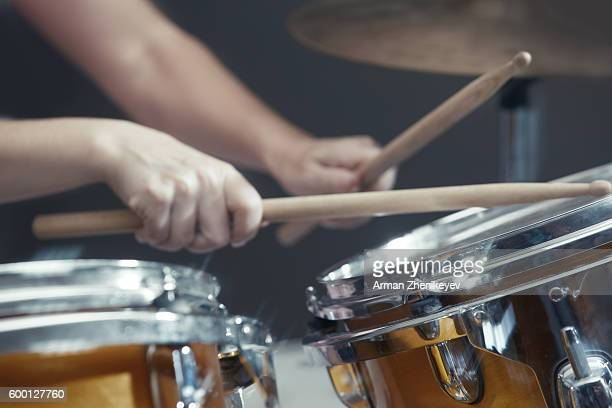 Professional musician playing drum at record studio