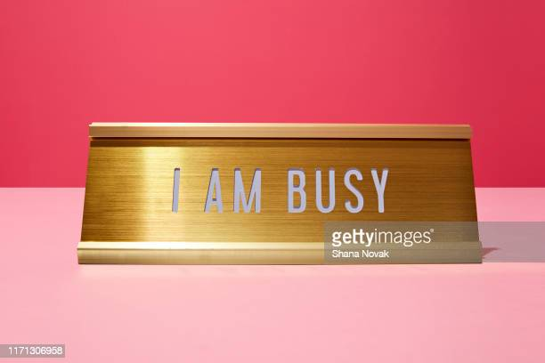 "professional nameplate reads i am busy - ""shana novak"" stock pictures, royalty-free photos & images"