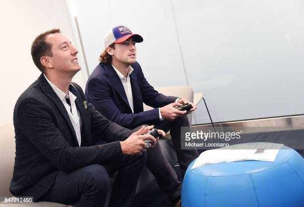Professional NASCAR drivers Kyle Busch and Ryan Blaney compete against each other in a video game at SiriusXM Studios on September 14 2017 in New...
