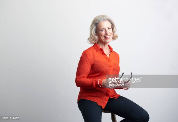 professional older woman sitting on chair