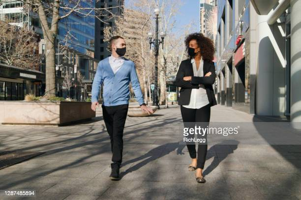 professional people wearing facemask in downtown - salt lake city stock pictures, royalty-free photos & images
