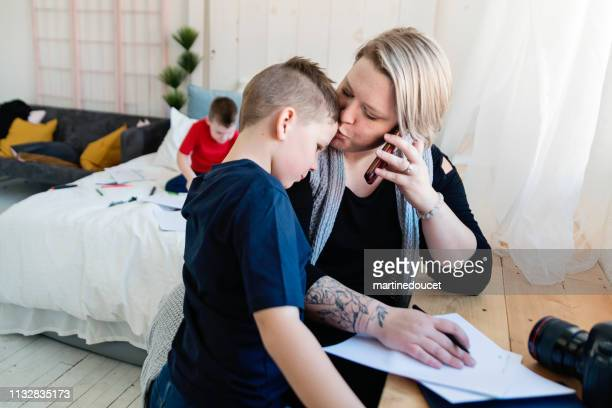 professional photographer mother working with her two sons. - showus stock pictures, royalty-free photos & images