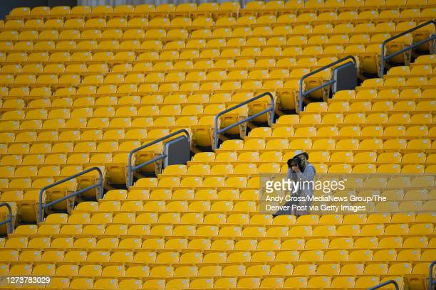 Professional photographer photographs the Pittsburgh Steelers game against the Denver Broncos from the stands in the second half of the game at Heinz...