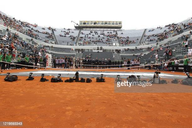 Professional photographers' cameras are seen on the ground as Italian tennis federation officials and Italian Olympic Committee CONI members...