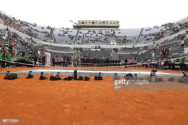 Professional photographers' cameras are seen on the ground as Italian tennis federation officials and Italian Olympic Committee, CONI, members...
