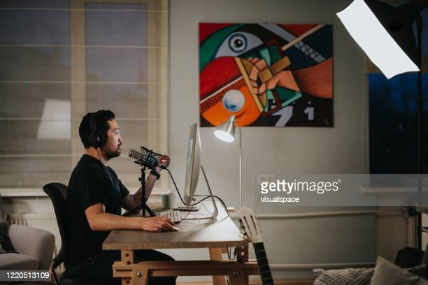Professional podcaster in his home studio