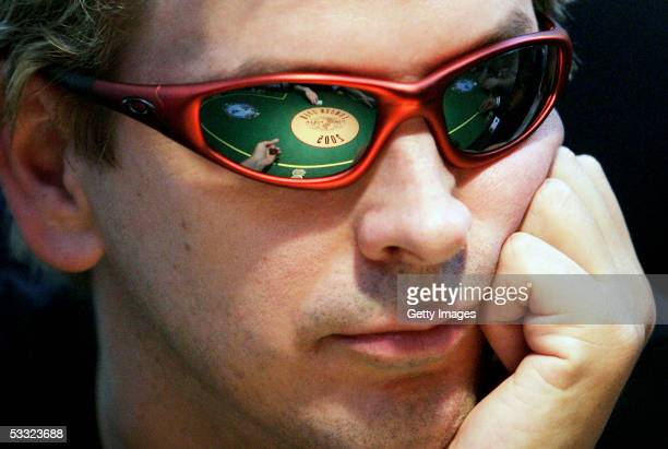Professional poker player Phil Laak competes on the second day of the first ever cards tournament hosted by online poker website World Poker Exchange...