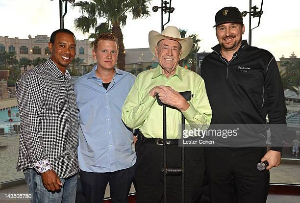 Professional poker players Tiger Woods Ben Lamb Doyle Brunson and Phil Hellmuth participate in Tiger's Charity Poker Night during Tiger Jam 2012 at...