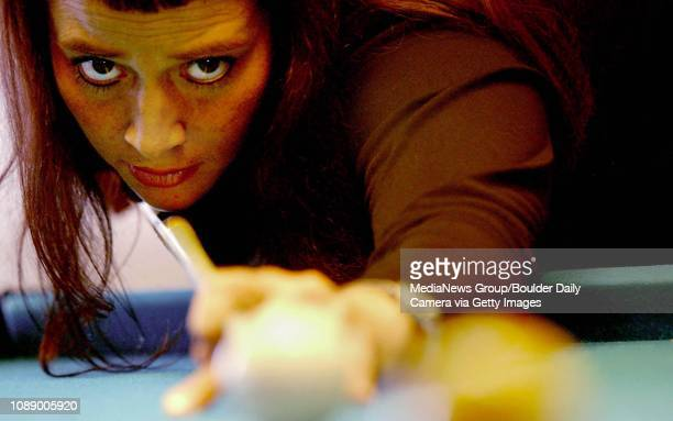Professional pool player Melissa the Viper Little lines up a shot on a pool table from Broomfield at Bueno Tiempos mexican restaurant in Broomfield
