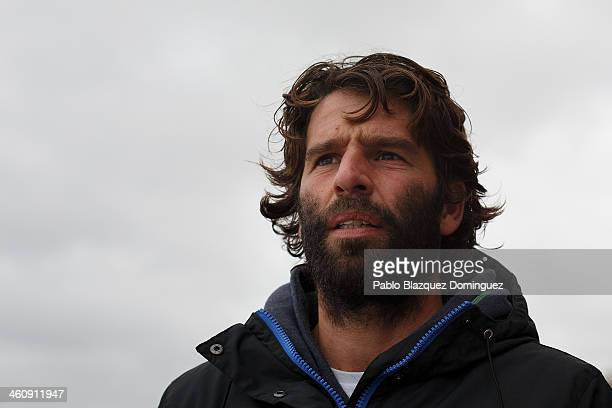 Professional Portuguese surfer Hugo Vau checks the waves and the wind condition for a possible attempt to surf at North Beach on January 6 2014 in...