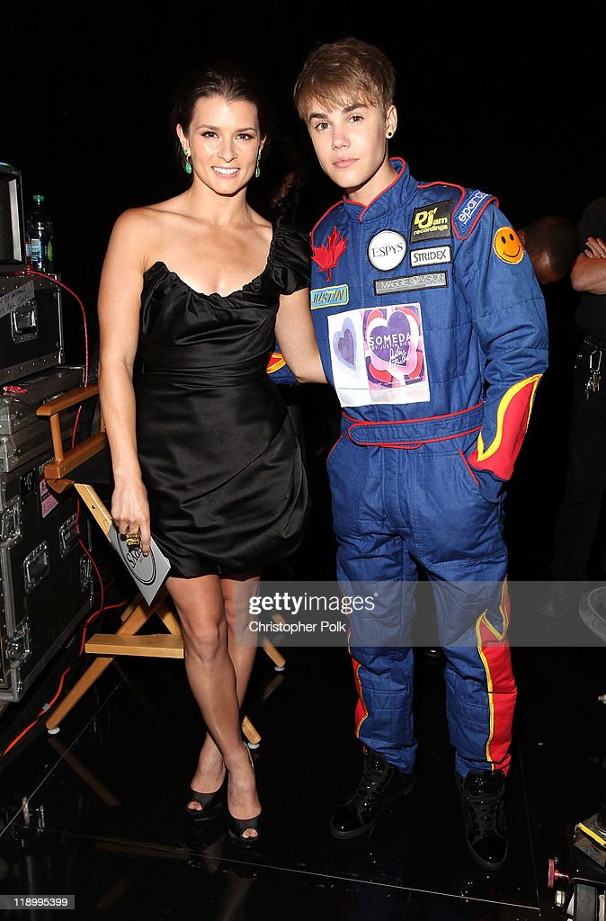 Professional race car driver Danica Patrick and singer Justin Bieber attend The 2011 ESPY Awards at Nokia Theatre L.A. Live on July 13, 2011 in Los Angeles, California.