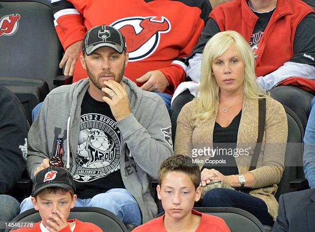 Professional race car driver Kevin Harvick and Delana Harvick attend the Los Angeles Kings vs the New Jersey Devils game one during the 2012 Stanley...