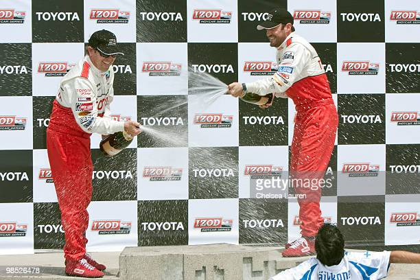 Professional racecar driver Jimmy Vasser and actor Brian Austin Green in the winner's circle at the Toyota Grand Prix Pro / Celebrity Race Day on...